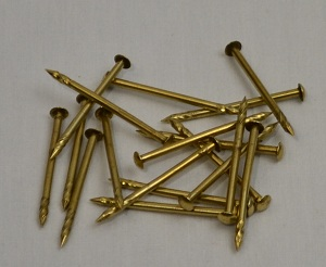 25 Used Brass Playfield Nails - Polished and shined
